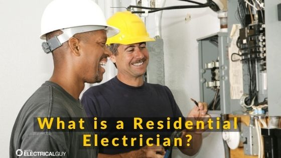 2 smiling electricians working on a service panel