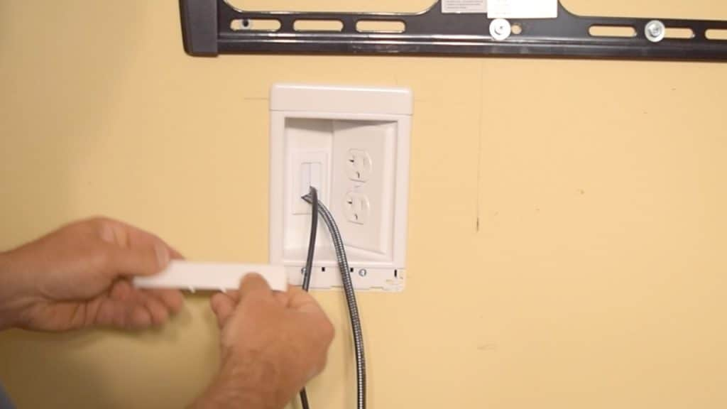 Installing a plug and trim pieces to the recessed tv box